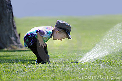 Boy Playing with Sprinkler