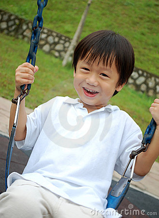 Boy playing swing