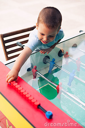 Boy playing table soccer