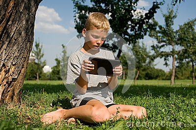 Boy playing in the tablet PC