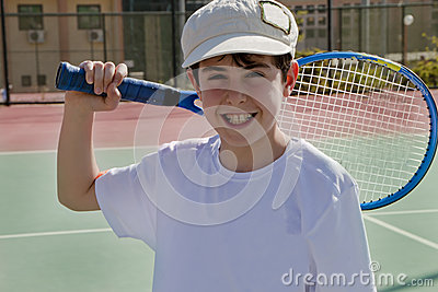 The Boy is Playing Tennis