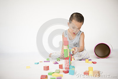 Boy playing toy bricks Stock Photo