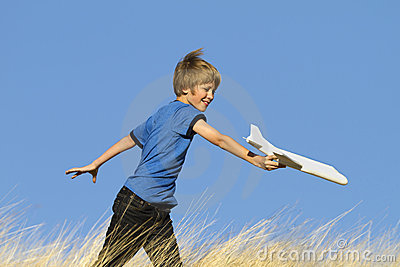 Boy Playing With Toy Glider Airplane