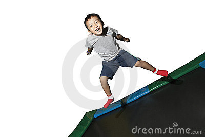 Boy playing on a trampoline