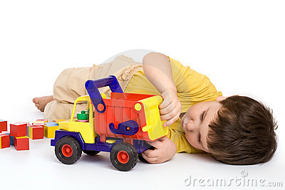 Boy playing with truck and blocks