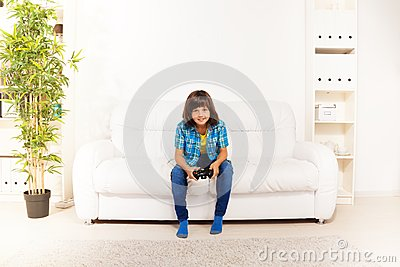 Boy playing videogame