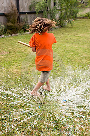 Boy playing with water balloon