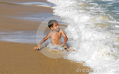 Boy playing in the waves