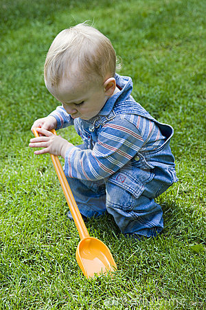 Boy playing in yard