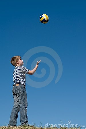 Boy plays a ball