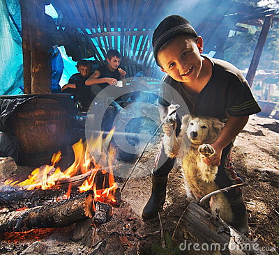 A boy plays with a dog Editorial Photography
