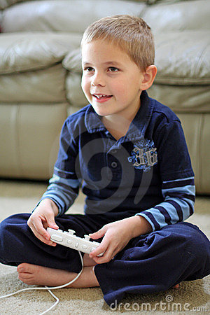 Boy plays handheld video game