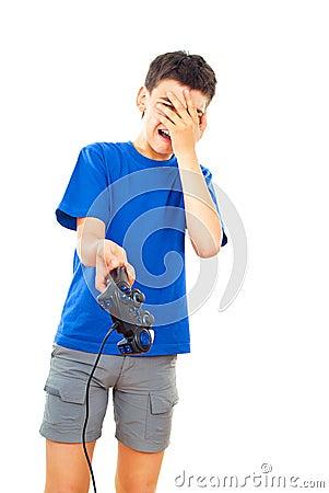 Boy plays with a joystick