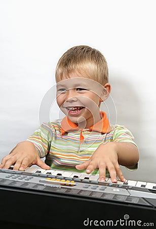 Boy plays piano