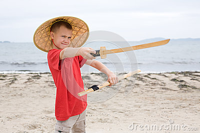 Boy plays with a samurai sword