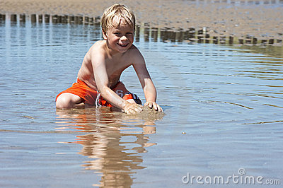 Boy plays with sand