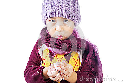 Boy plays snow in Christmas isolated over white