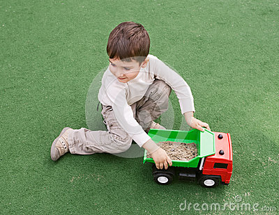 Boy plays with toy car