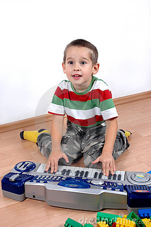 Boy plays the toy piano
