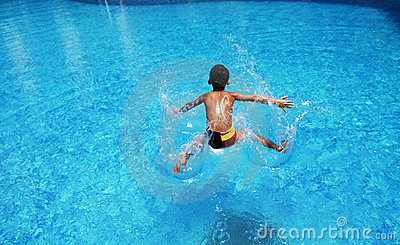 The boy plunge into  water