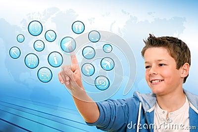 Boy pointing at virtual web icons.