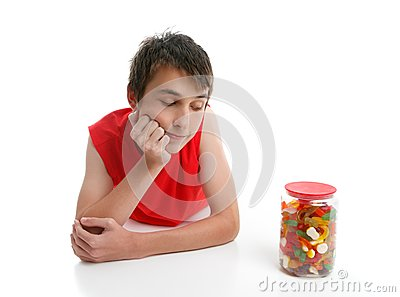 Boy ponders to open jar confectionery