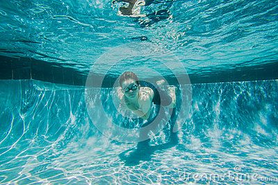 Under the water with confidence in a pool wearing swim goggles