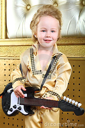 Boy in pop retro suit with guitar