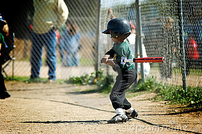 Boy practicing his tball swing