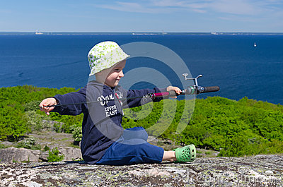 Boy prepares for fishing