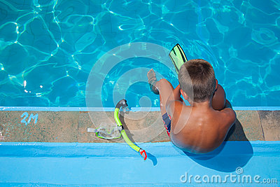 Boy preparing to dive into pool 1.