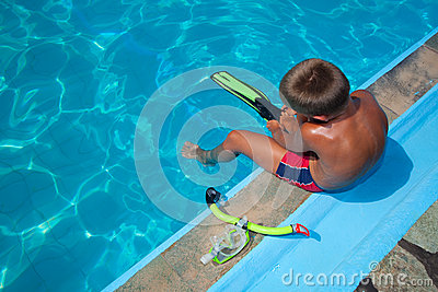 Boy preparing to dive into pool 2