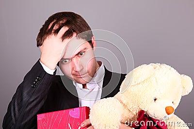 Boy with present box and teddy bear