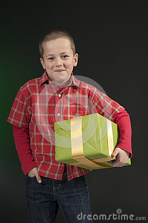 Boy present on dark green