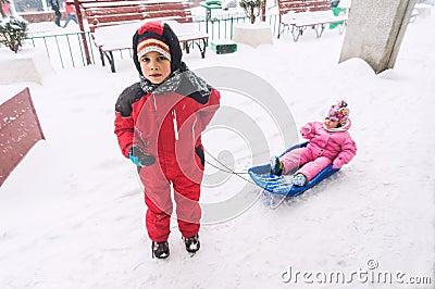 Boy pulling bob sledge