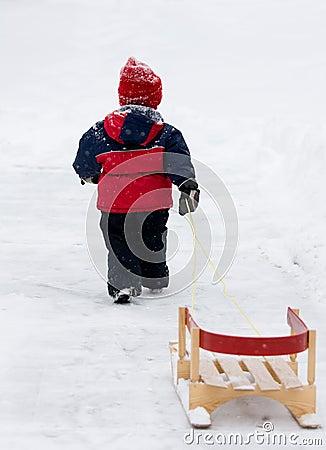Boy pulling sled