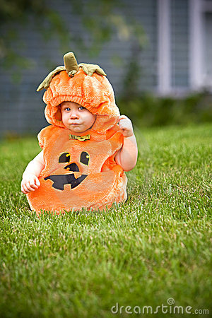 Boy in pumpkin costume