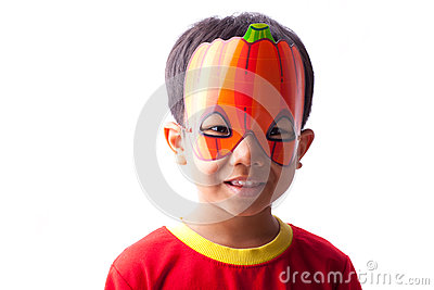 Boy with pumpkin mask