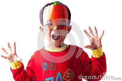 Boy in pumpkin mask