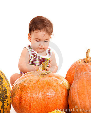 Boy among pumpkins