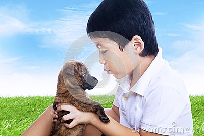 Boy and puppy outdoor