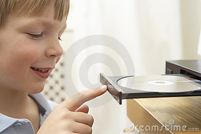 Boy Putting Disc In DVD