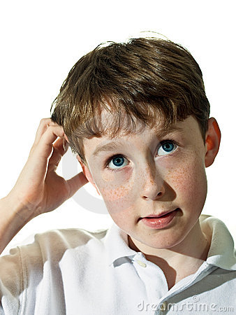Boy with puzzled look