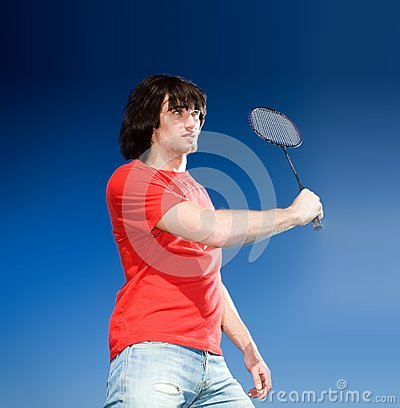Boy with racket on blue background
