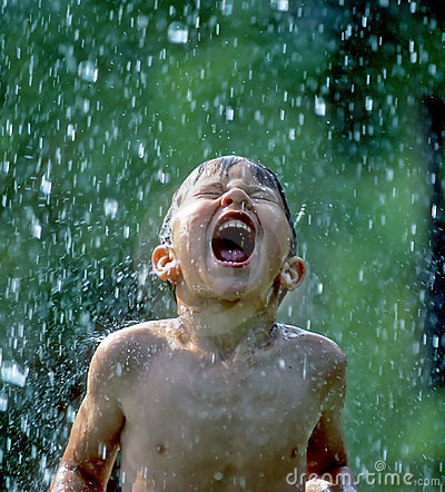 Boy Catching Rain In His Mouth
