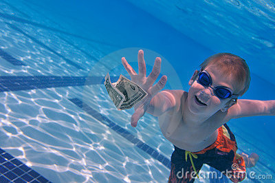 Boy reaching dollar bill