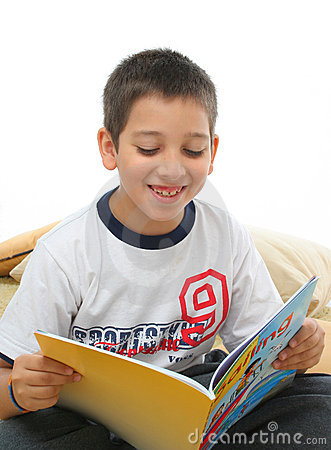 Free Boy Reading A Book On The Floor Royalty Free Stock Image - 728336