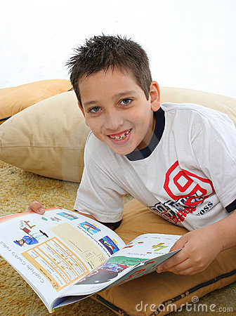 Free Boy Reading A Book On The Floor Stock Photography - 728352