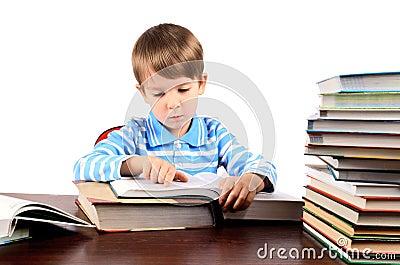 Boy reading a big book