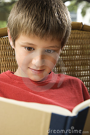 Boy reading book.